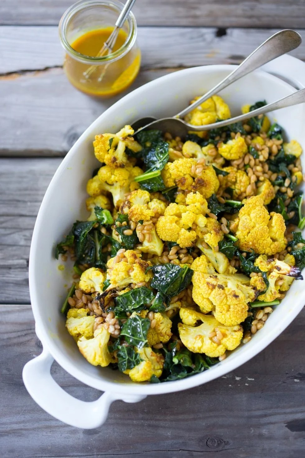 10 Simple Powerful Turmeric Recipes to Heal, Sooth and Protect | Add fresh turmeric to dressings for a punch of flavor and anti-oxidants | Roasted cauliflower salad with Turmeric Dressing | www.feastingathome.com