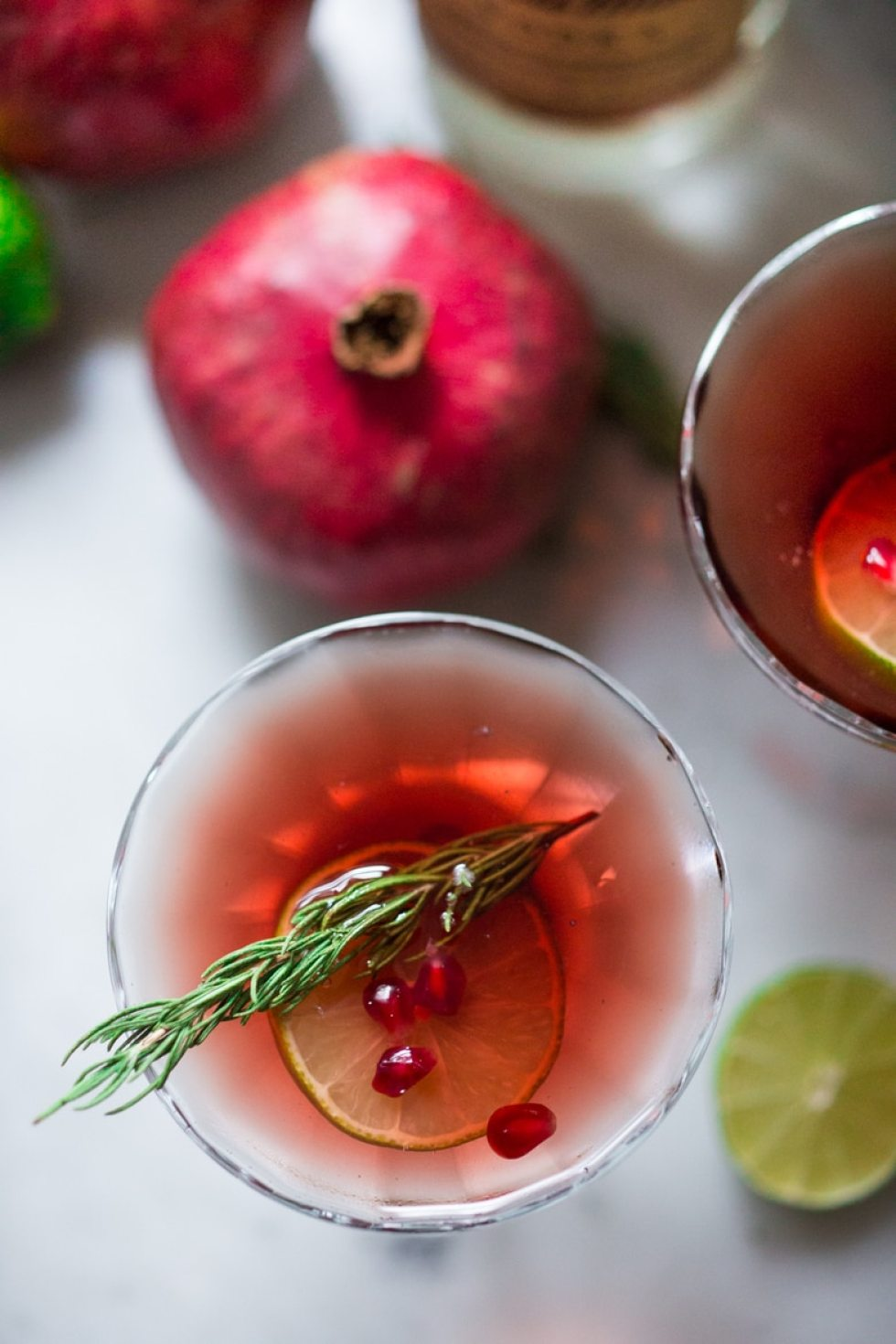 A simple recipe for a Pomegranate Drop with Rosemary ...a refreshing and festive holiday cocktail. | www.feastingathome.com
