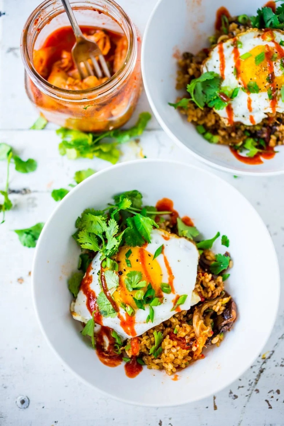 Kimchi Fried Rice, packed with flavor & veggies, topped with an Egg ( or Tofu). Swap out Cauliflower Rice for Low Carb! Healthy and flavorful! |www.feastingathome.com