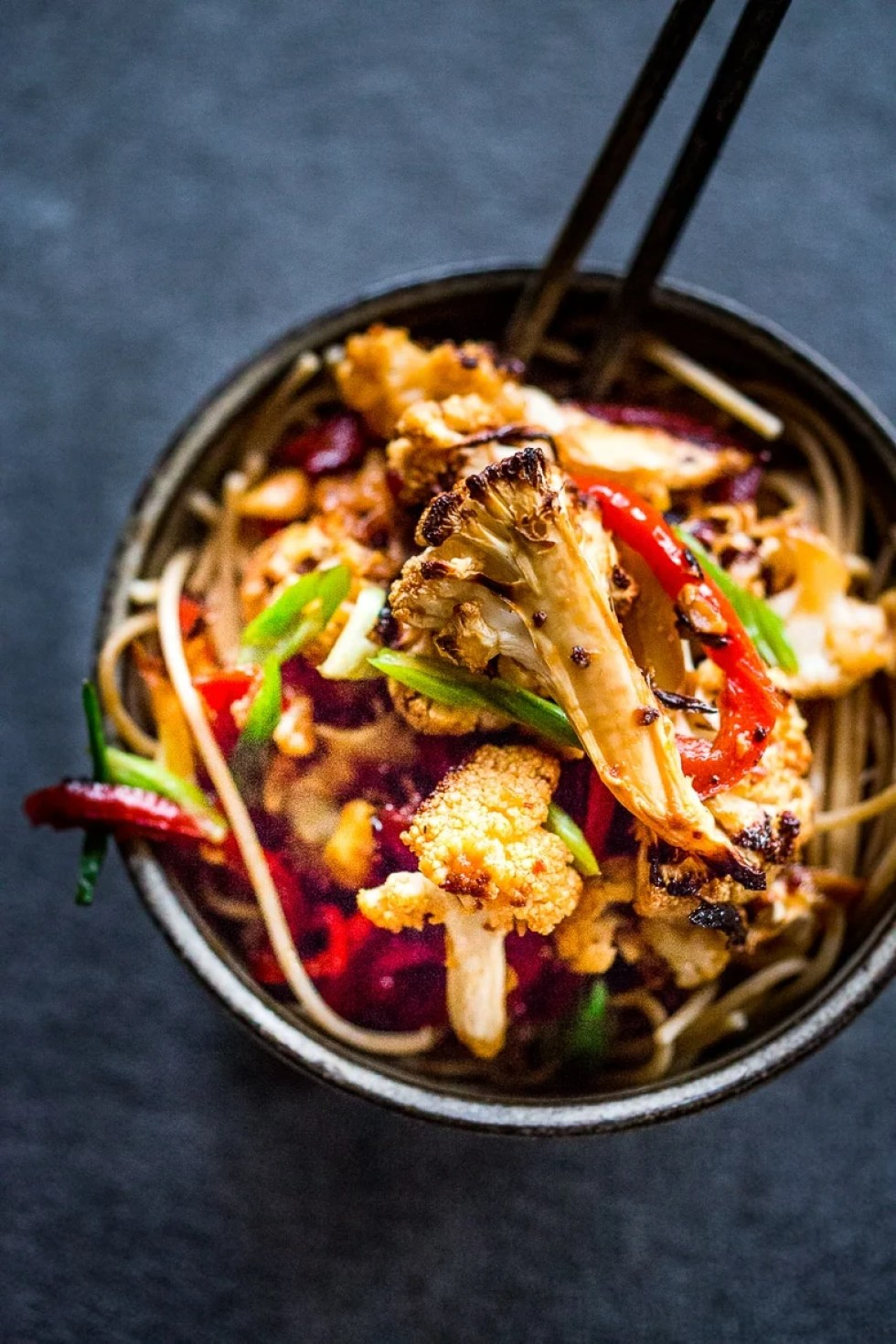 Kung Pao Cauliflower over noodles. Fast and delicious! | www.feastingathome.com