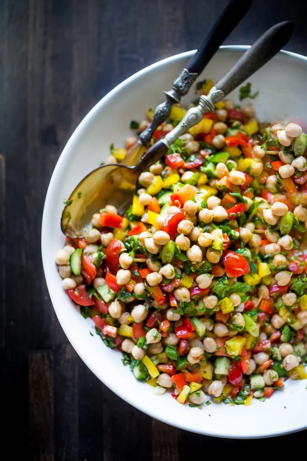 EAT CLEAN with these 20 simple Plant-Based Meals!!!   Middle Eastern Balela Salad with chickpeas & fresh chopped veggies bursting with Middle Eastern flavor. Stuff in a pita or wrap, or eat on its own!  www.feeastingathome.com