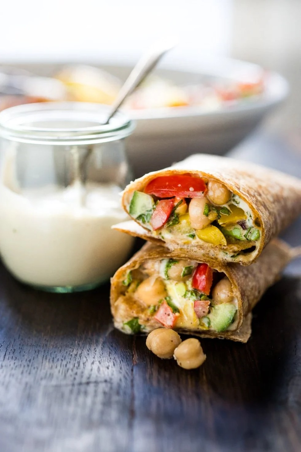A simple & delicious recipe for a Balela Salad Wrap, made w/ finely chopped vegetables, chickpeas, fresh herbs, lemon & olive oil. Serve in a tortilla with tahini sauce or over greens. | www.feastingathome.com