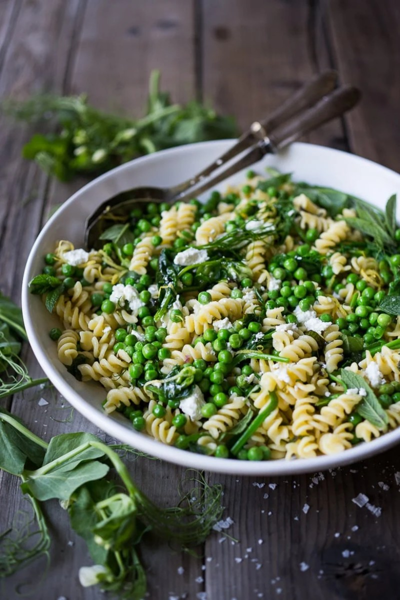 A delicious seasonal recipe for Spring Pea Pasta with truffle oil, lemon and mint. Flavorful and simple to make, this can be served warm or chilled. | www.feastingathome.com