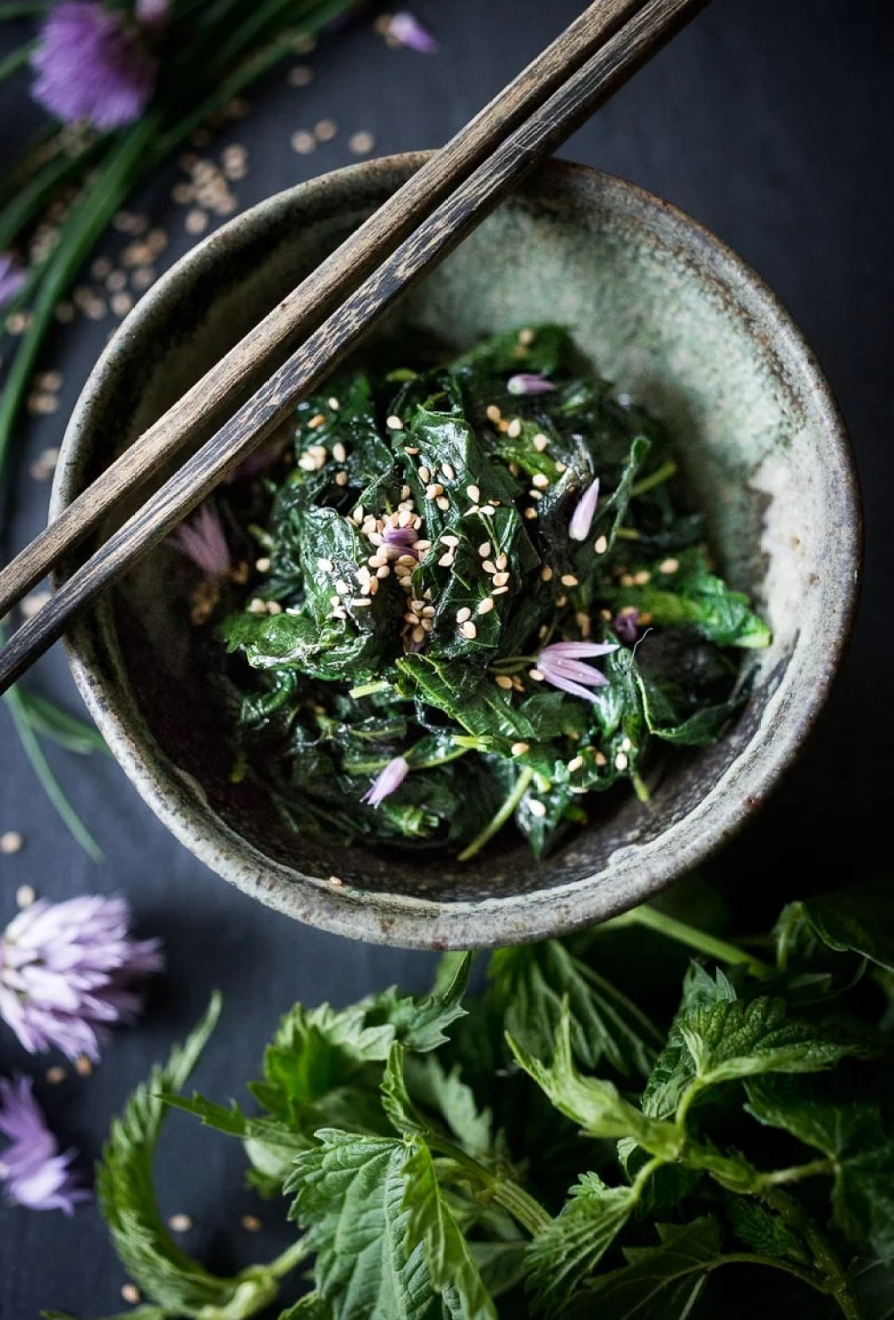 STEAMED NETTLES w/ TOASTED SESAME SEEDS & CHIVE BLOSSOMS