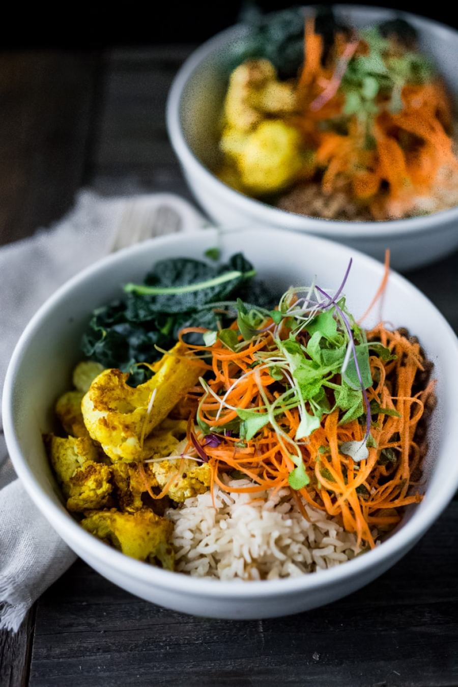 Fall Nourish Bowl- Curried cauliflower, lentils, brown rice, kale and a refreshing Carrot Slaw topped with Turmeric vinaigrette. VEGAN & Gluten-free. | www.feastingathome.com