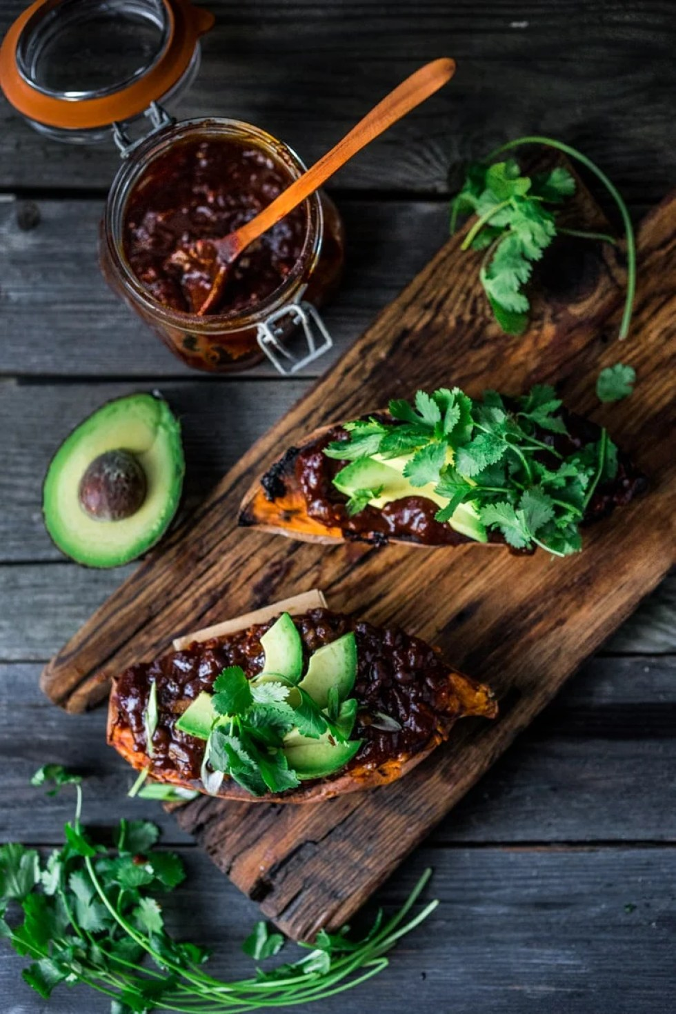 BBQ Chicken (or Black Bean ) Stuffed Sweet Potato- keep with vegan with black beans and avocado, or add chicken and melty cheese, and top with cilantro. Either way a win!! #glutenfree #vegan | www.feastingathome.com