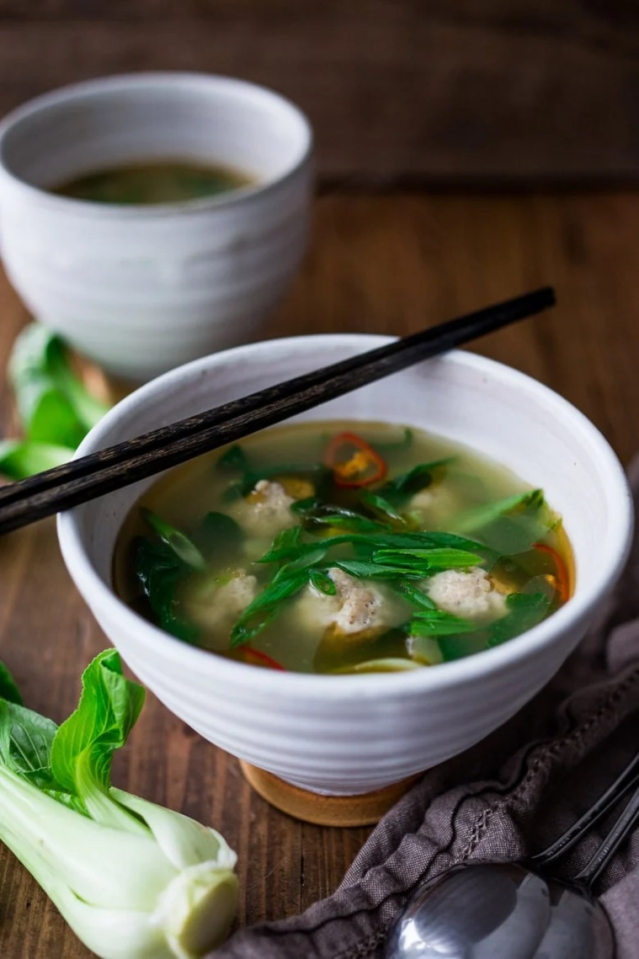 A healing recipe for Chicken Wonton-Less Soup with Bok Choy- a simple flavorful broth-based soup that is paleo, low carb and gluten free. | www.feastingathome.com
