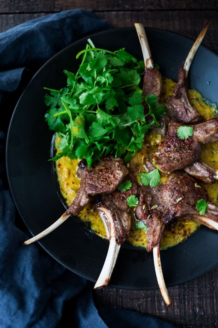 An incredibly delicious recipe for Roasted Lamb Chops with Indian Curry Sauce, perfect for romantic dinners or entertaining at home. Fragrant & Flavorful! | www.feastingathome.com