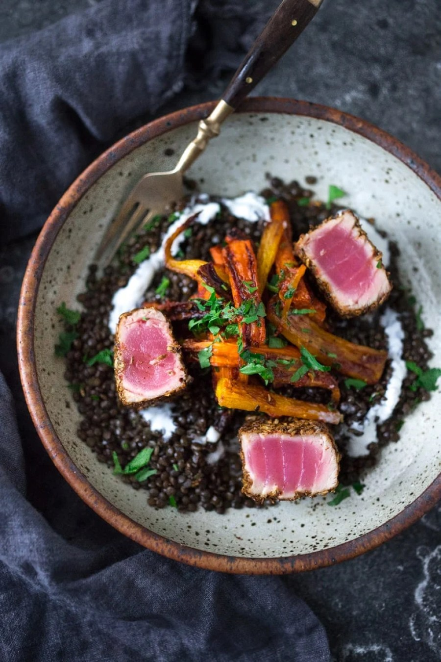 Fennel and Cumin Crusted Ahi served over Seasoned Black Beans with Roasted Carrots | www.feastingathome.com