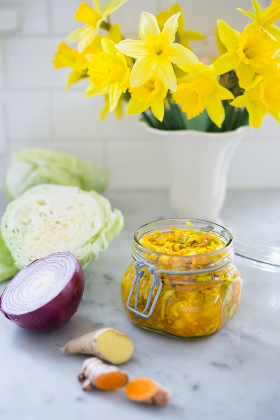 Simple Turmeric Sour Kraut- a small-batch recipe that can be put together in 10 minutes, and sits on the couture for 3-5 days. | www.feastingathome.com