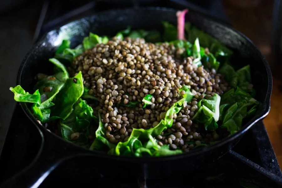Warm Lentils with wilted chard, roasted beets, goat cheese and spring herbs. A simple tasty vegetarian meal!   www.feastingathome.com