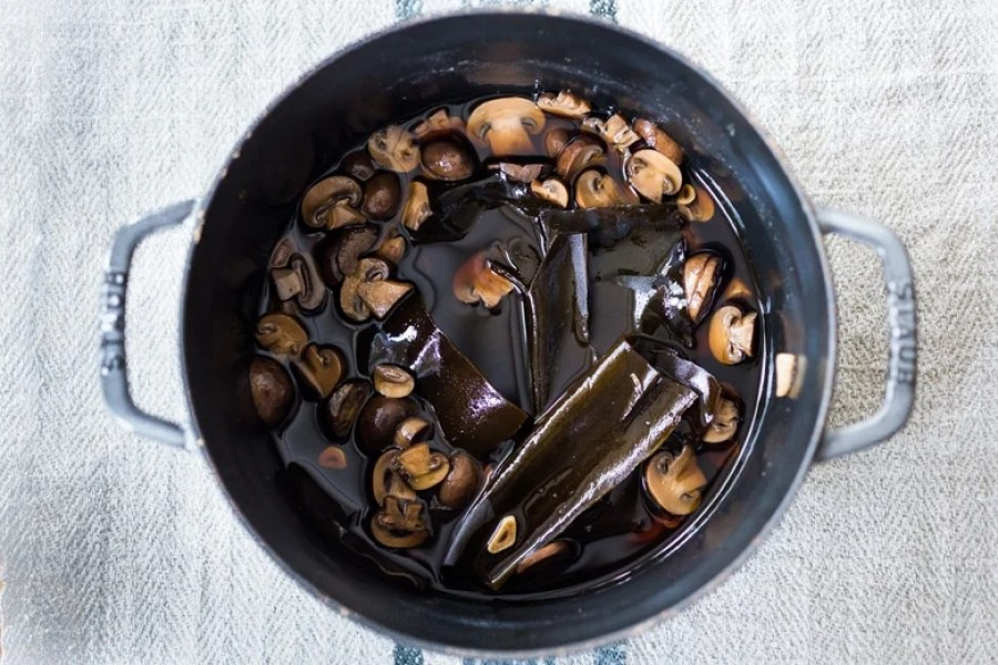 A simple recipe for Vegan Fish Sauce - a great substitute for fish sauce that adds depth and umami flavor to Asian dishes. Gluten-free adaptable. | www.feastingathome.com