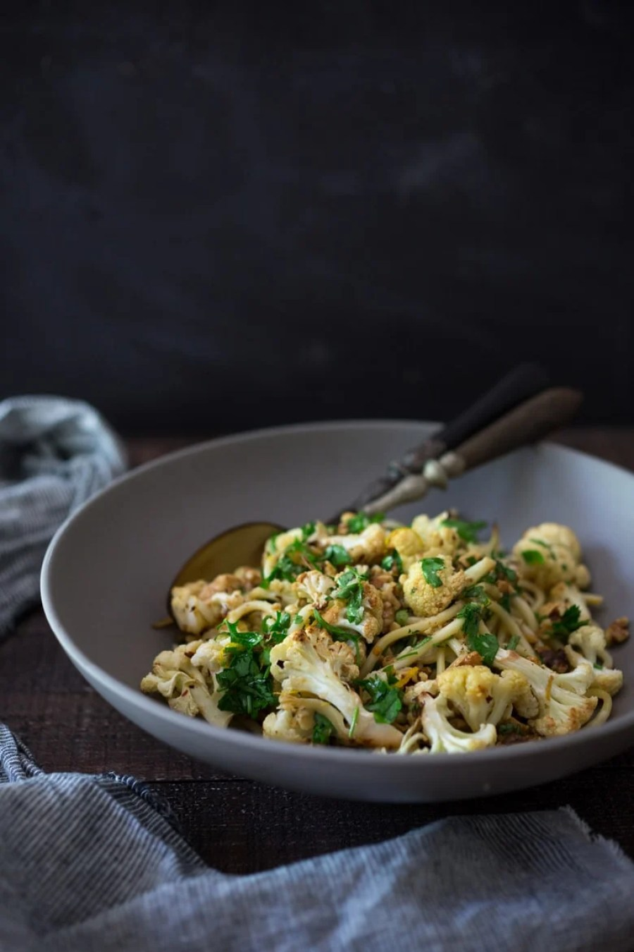 Roasted Cauliflower Pasta with Toasted Walnuts, Parsley, Garlic and Lemon Zest - a delicious vegan dinner that can be made in 30 minutes!   www.feastingathome.com