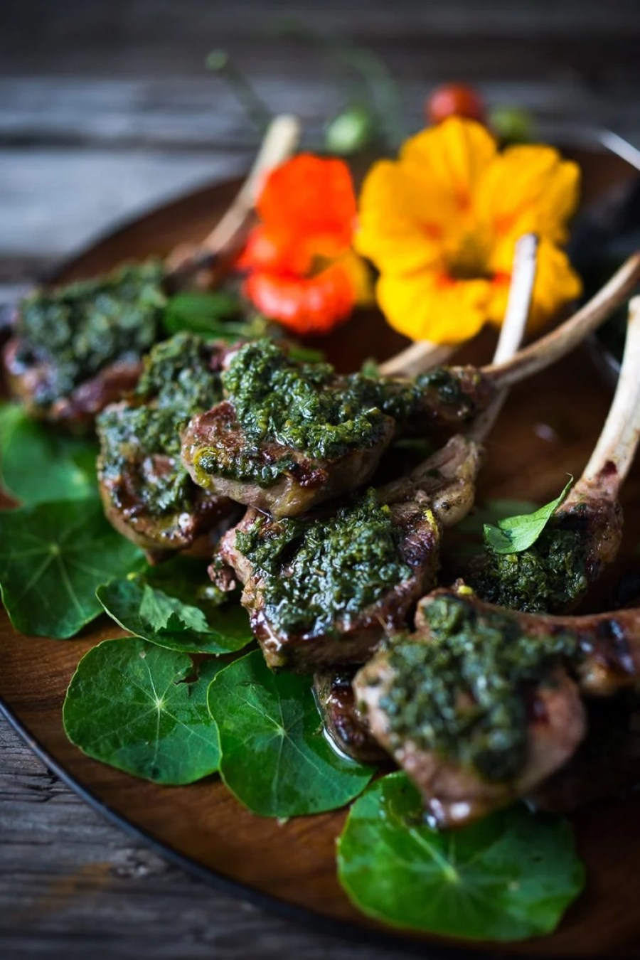 Grilled Lamb Lollipops with Salsa Verde - grilled single lamb chops topped with the most flavorful Italian Herb Caper Sauce, called Salsa Verde. Serve as a a quick, easy appetizer. Fast, flavorful and so delicious! | www.feastingathome.com