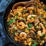 Spanish White bean, Shrimp and Sausage Skillet- a simple, healthy & flavorful, one-pan meal that can be on the table in 20 minutes! | www.feastingathome.com