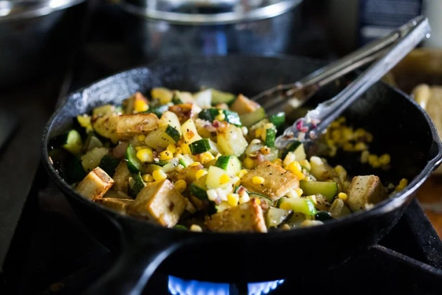 A fast and healthy dinner -Zucchini, Corn and Basil Skillet topped with your choice of shrimp, tofu or chicken. Simple and adaptable. Vegan, Gluten-free!