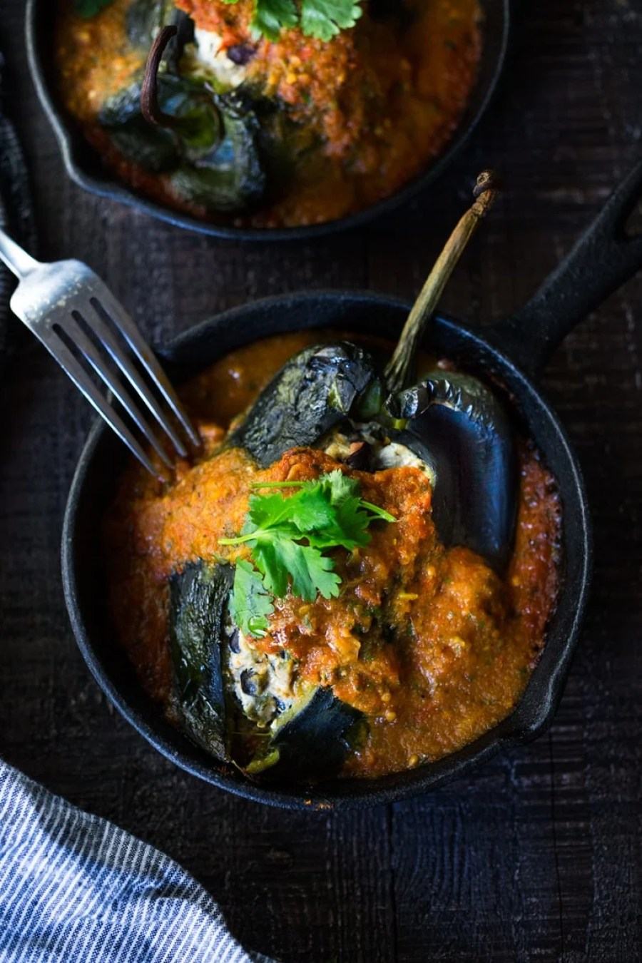 VEGAN Roasted Chile Rellenos with black beans- a healthy lightened up version that is roasted instead of fried and is gluten free! #vegan #chilerellenos | www.feastingathome.com