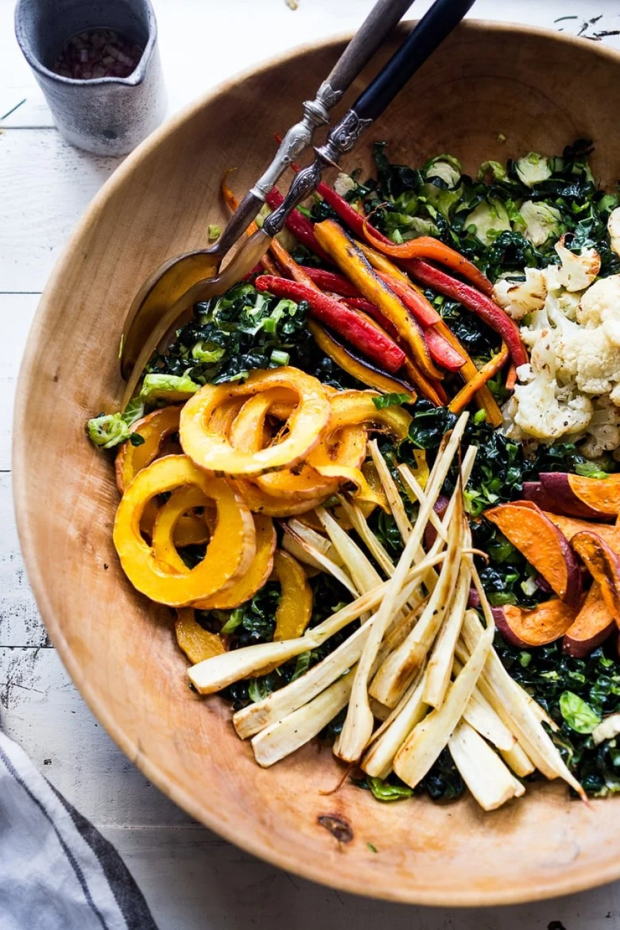 EAT CLEAN w/ these 20 simple PLANT-BASED MEALS! Like this Roasted Veggie Salad over Kale and Brussel Slaw with a Curry Maple vinaigrette. Delicious an healthy! VEGAN GF!   www.feastingathome.com