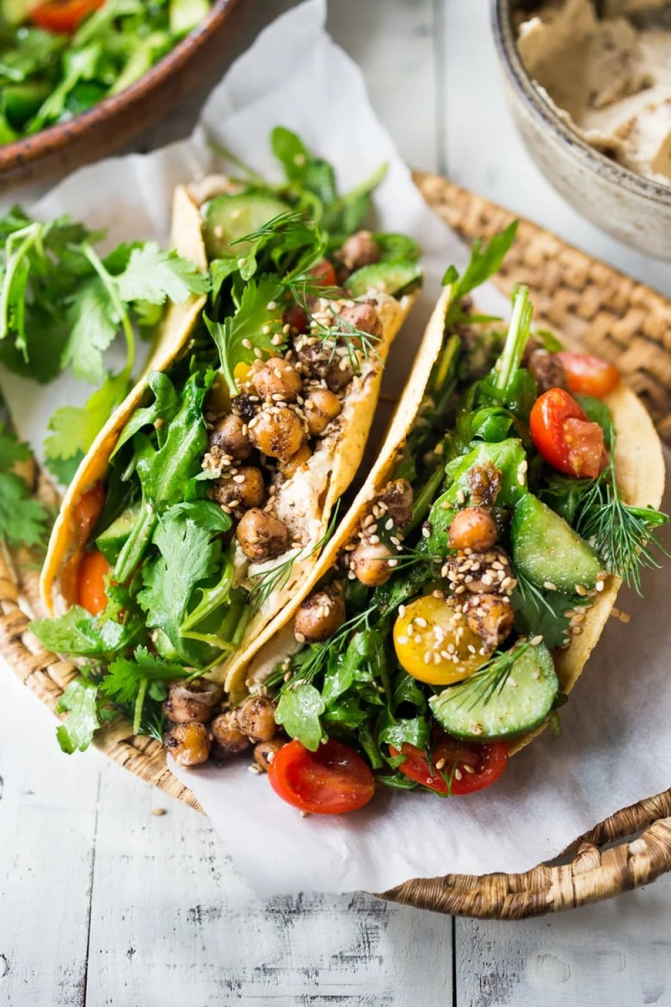 Middle Eastern Salad Tacos with spiced chickpeas, hummus and a mound of lemony salad, topped with fresh herbs and scallions. Vegan & sooooo Delicious! | www.feastingathome.com