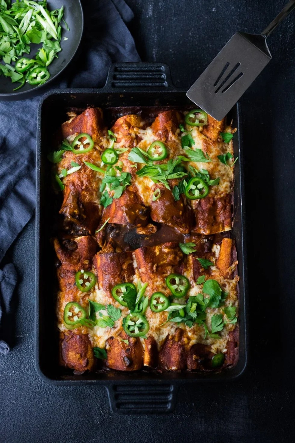 Leftover Turkey has never tasted so good! Here's a simple tasty recipe for Turkey Enchiladas with Black Beans - Fast and Easy and can be made with rotisserie chicken too! | www.feastingathome.com