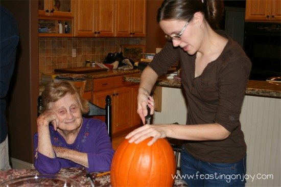 Sarah carving her pumpkin