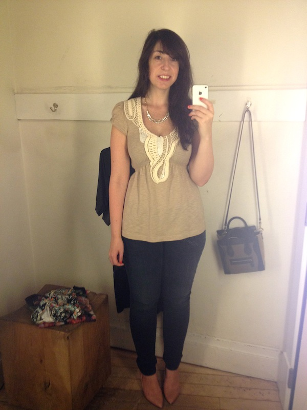 Doing an Anthropologie fitting room review (with her Nano in the background!)