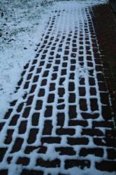 snowy brick patio