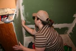 Clare sanding drywall mud