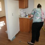 Clare works on sweeping the kitchen