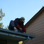Once we had acquired a ladder, Rob cleaned out the filthy gutters.