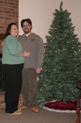 Rob and Clare by the christmas tree (with new slippers)