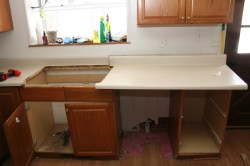 Taking out the old old counter top and cabinets by the sink