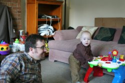 Spencer and Rob playing in their cords and plaid
