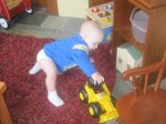 Spencer playing with a truck at the Buchheits