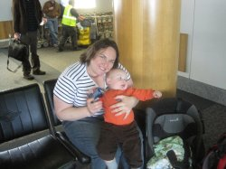 Clare and Spencer in the airport waiting to return home