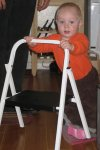 Spencer playing with a stepstool. He is king of the ladder