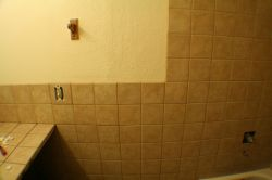 Wall behind toilet grouted