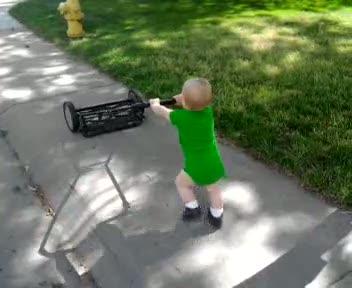 Spencer pushing the reel mower