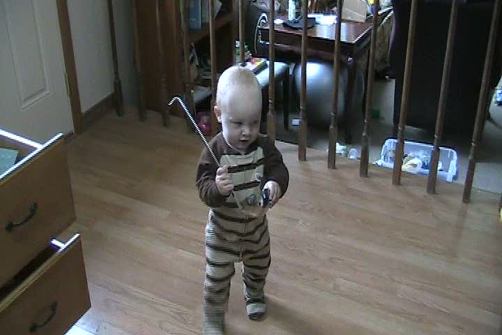 Spencer playing with a ladle