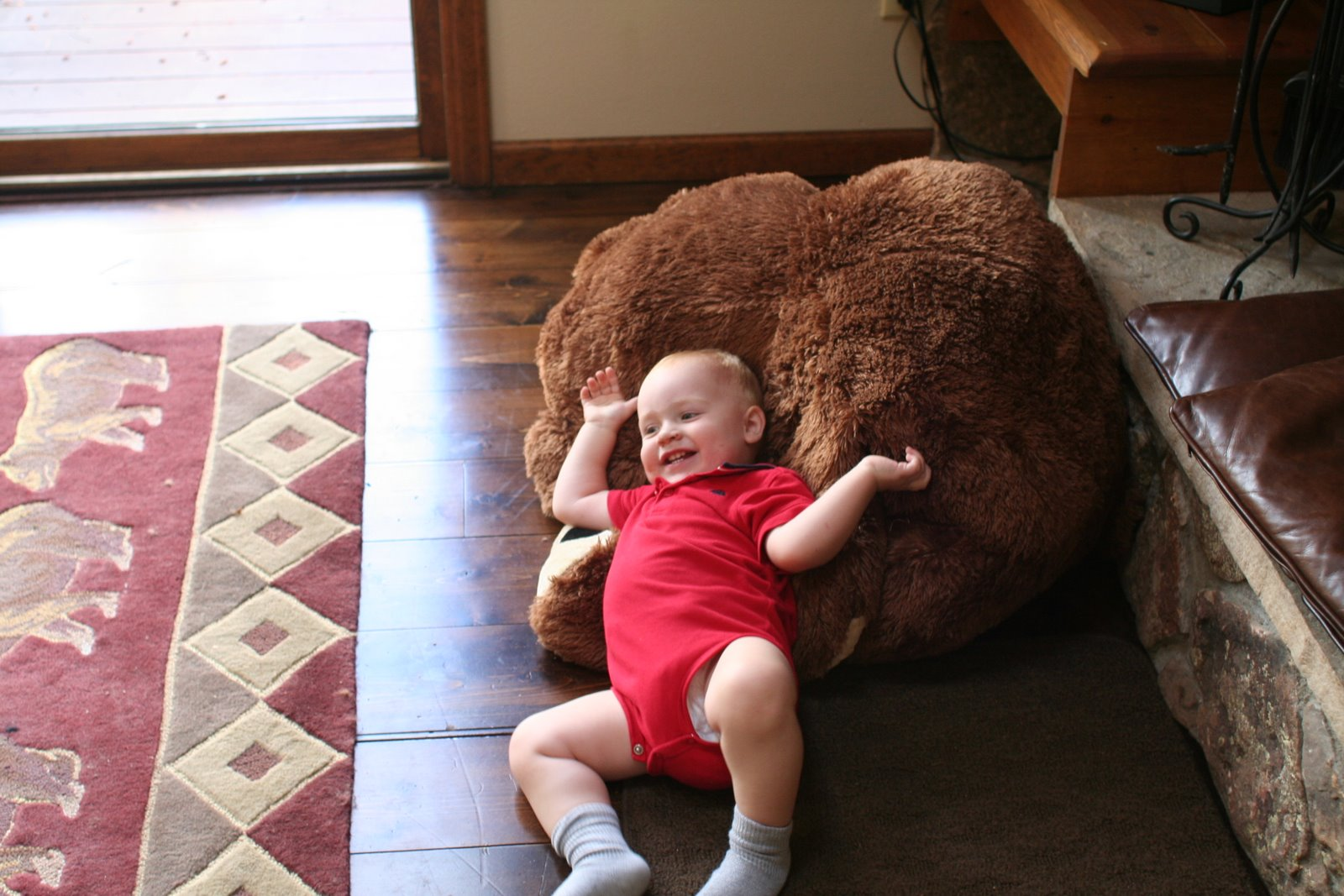 Spencer also likes playing with the big fuzzy bear at the cabin