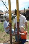 Spencer and Dave enjoy the swings at the Elkhorn Lodge in Estes Park