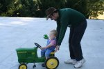 Rob pushing Spencer on the toy tractor