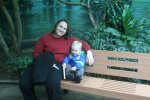 Clare and Spencer relax on a bench in bird world
