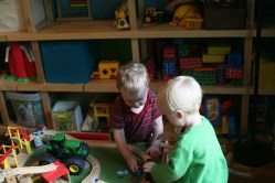 Spencer and Aaron playing trains
