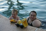 Spencer and Clare playing diggers in the pool