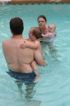 Rob, Ellen, Meg, and Spencer in the pool
