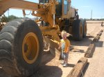 Spencer checks out the grader at the olive oil place