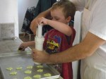 Spencer helps pump out the spritz cookies