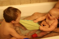 Meg and Spencer playing in the bathtub