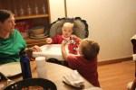Spencer helps Meg open a present